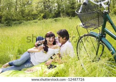 couple having a picnic in a park, smiling