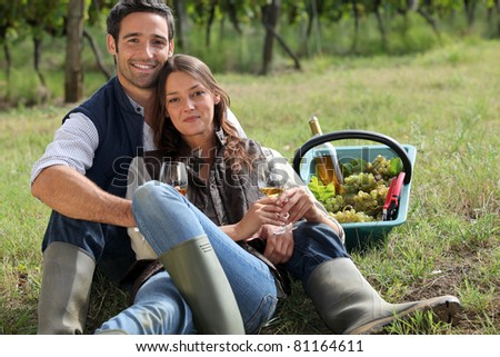 Couple having a picnic in a vineyard