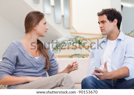 Couple having an argument in their living room