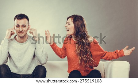 couple having argument conflict bad relationships Angry fury woman screaming man closing his ears