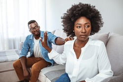 Couple Having Argument - Conflict, Bad Relationships. Unhappy Couple After an Argument in the Living Room at Home. Making Decision of Breaking Up Get Divorced