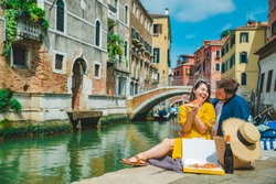 couple having date at pier with beautiful view of venice canal
