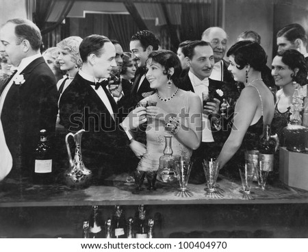 Couple having drink at crowded bar