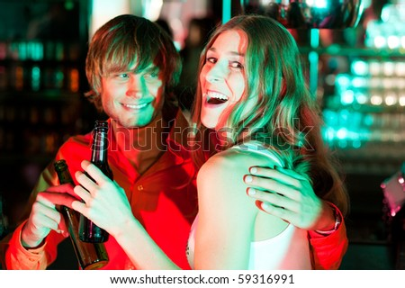 Couple having drinks in a bar or nightclub