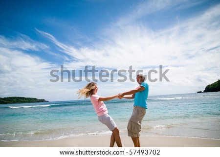 couple having fun at seaside
