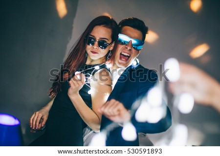 Couple having fun at the club. New year party