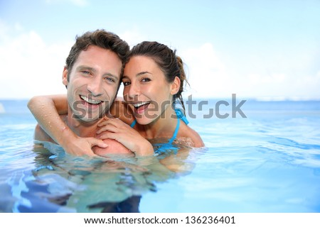 Couple having fun in swimming-pool