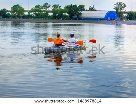 Couple having kayaking on the canal