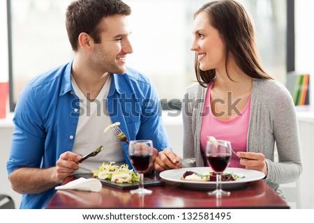 Couple having meal in restaurant