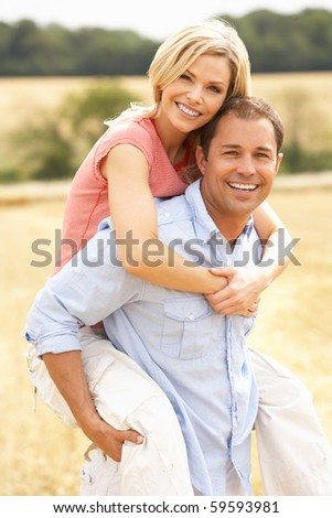 stock photo : Couple Having Piggyback In Summer Harvested Field