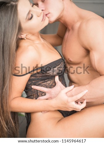 Couple having sex. Hands holdings, a sign of ecstasy, feeling of pleasure. kisses. #1145964617