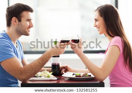 Couple having toast in restaurant