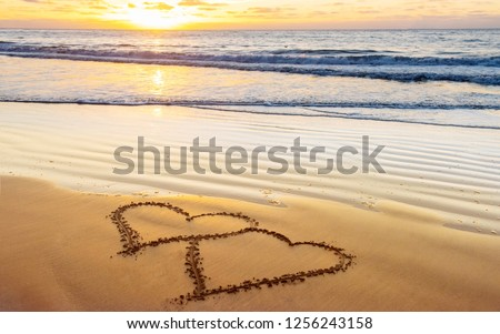 Couple hearts on sea beach. Valentine day and love concept #1256243158
