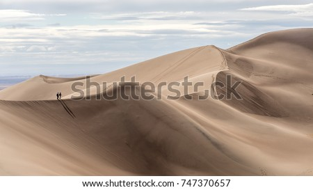 Couple hiking at Great Sand Dunes National Park, Colorado #747370657