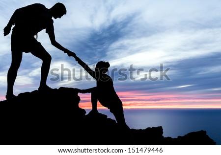 couple hiking help teamwork and ...
