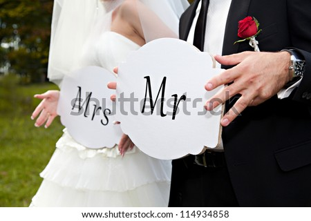 Couple hold card with text MR and MRS - stock photo