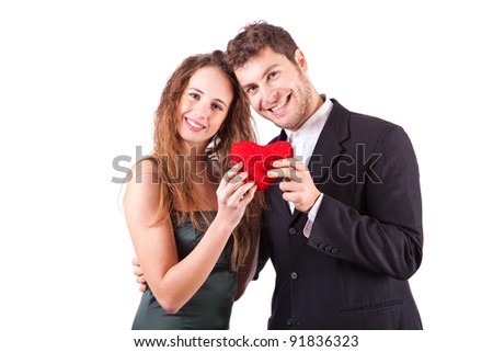 Couple Holding an Heart, symbol of Love, on Valentine's Day