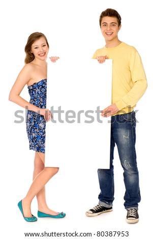 Couple holding blank billboard