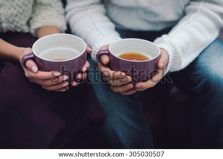 couple holding cups of tea #305030507