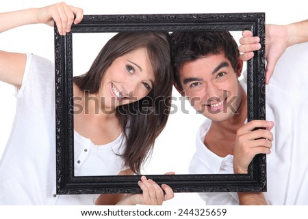 Couple holding empty frame