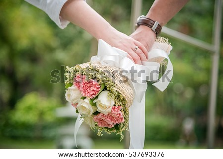 couple holding flower. #537693376