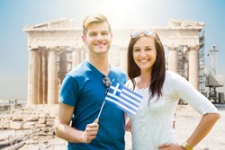 Couple Holding Greek Flag On Parthenon Temple Background In Acropolis