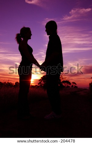 holding hands in sunset