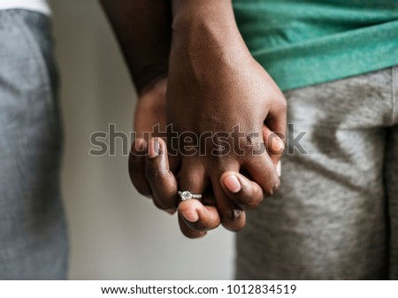 Couple holding hands closeup