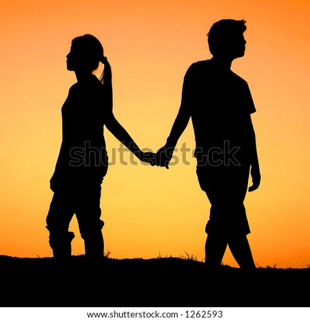 Holding Hands In Sunset. hands during sunset