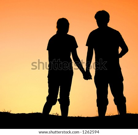 Holding Hands In Sunset. hands during sunset time