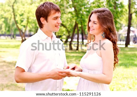 couple holding hands in the park, spending time with loved ones