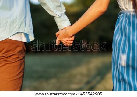 couple holding hands nature love relationship joy relationship