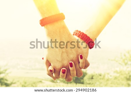 Couple holding hands on a sunny day