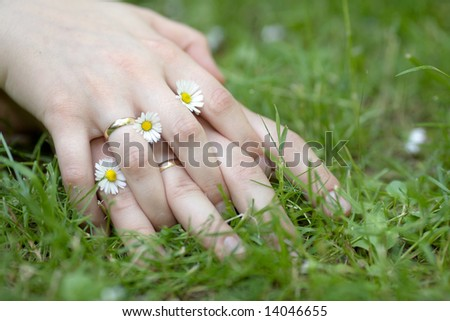 stock photo : Couple holding hands with wedding rings