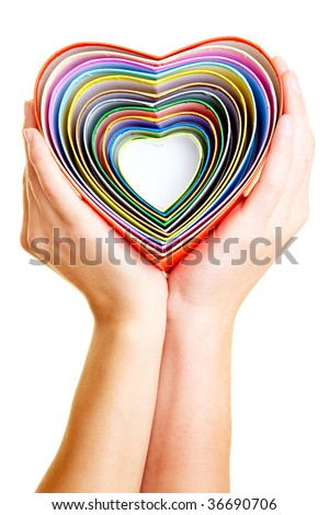 Couple holding many colorful hearts