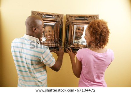 Couple holding mirror