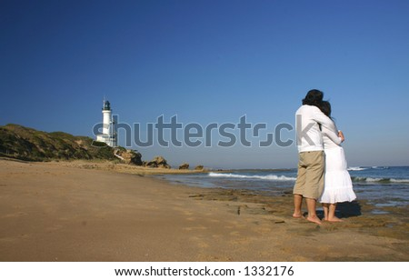 Couple hugging at the beach
