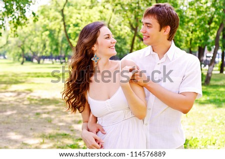 couple hugging in the park, have a good time together