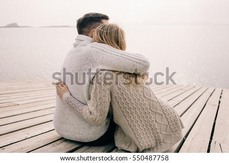 Shutterstock couple hugging on a pier