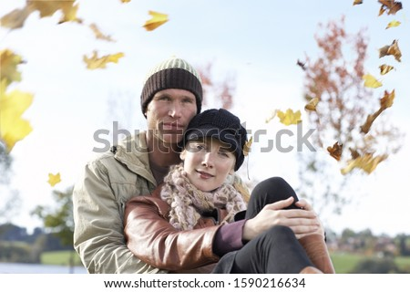 Couple hugging outdoors in autumn
