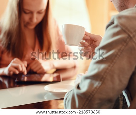 Couple ignoring each other busy with their mobile devices.