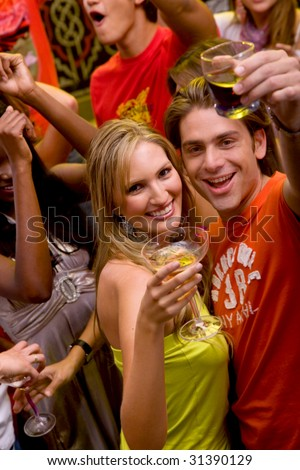 couple in a bar having a drink and smiling