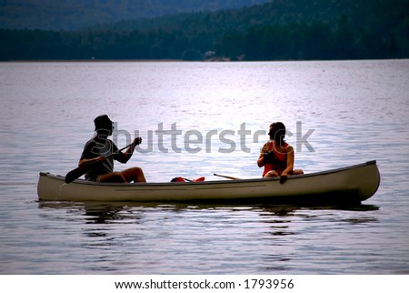 Couple in a canoe on a lake