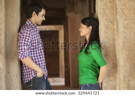 Couple in a fort looking at each other