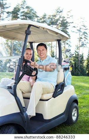 Couple in a golf car