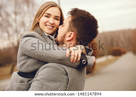 Couple in a park. Woman in a gray coat. Man with his wife #1481147894