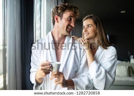 Couple in bathrobes enjoying honeymoon in spa resort