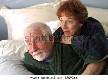 Couple in bedroom watching sunrise