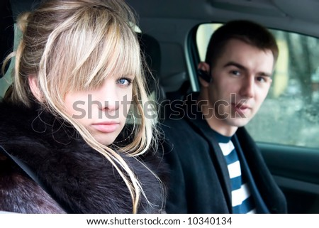 Couple in car. Young man and woman in car portrait.