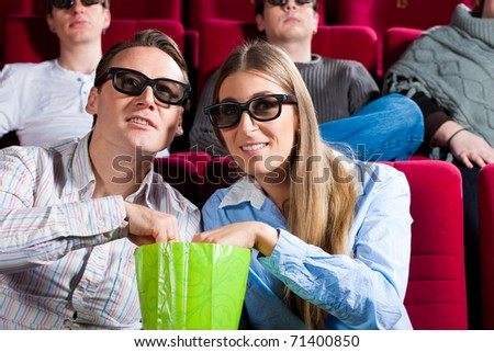 Couple in cinema watching a movie in 3D